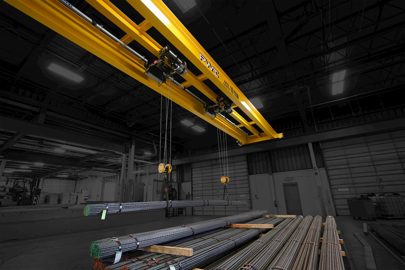 Overhead Cranes Lifting Material from Floor